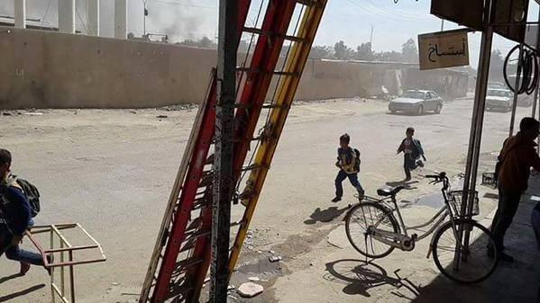 Schoolchildren fleeing an airstrike of unknown origin, Fallujah, March 3rd 2015.
