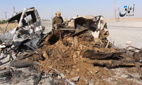 Image published by ISIL reportedly showing vehicle destroyed in 'coalition airstrike', May 26 2015