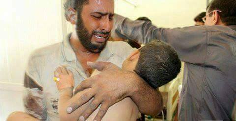 A man cradles a child casualty of an alleged Coalition strike at Hit, Oct 16th 2015 (via Iraqi Spring)