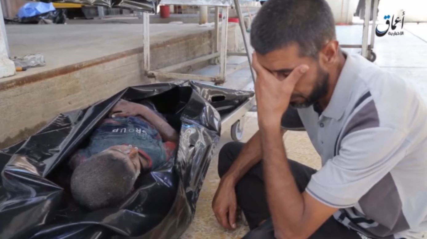 A father weeps next to his dead son, reportedly killed in a Coalition strike on Mosul, September 29th 2015 (via ISIL propaganda video)