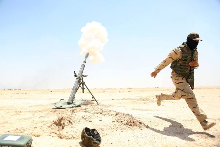 An Iraqi army soldier moves away from a 120 mm mortar he fires during training at Besmaya Range Complex, Iraq, June 16, 2015. - U.S. Army photo by Cpl. Nelson Rodriguez/CJTF-OIR Public Affairs