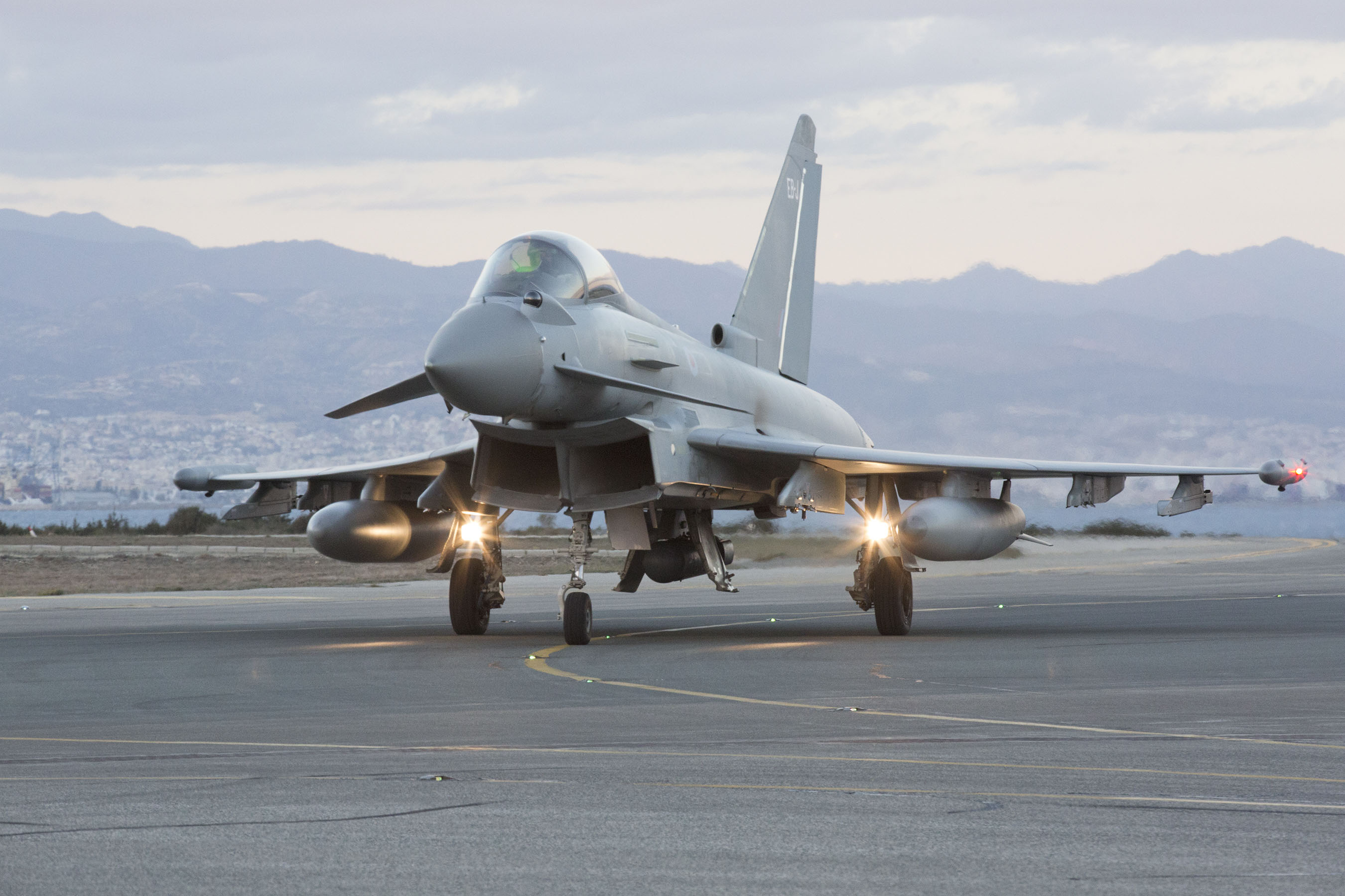 An RAF Typhoon lands in Cyprus hours after UK voted to extend airstrikes to Syria (UK MoD)