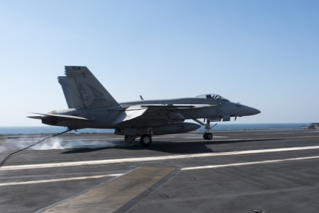 """An F/A-18E Super Hornet, assigned to the """"Pukin' Dogs"""" of Strike Fighter Squadron (VFA) 143, lands on the flight deck of aircraft carrier USS Harry S. Truman (US Navy photo)"""