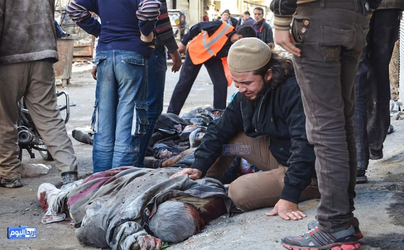 A man beside the body of a victim from the alleged Russian raid on Areeha, November 29th (via SN4HR)