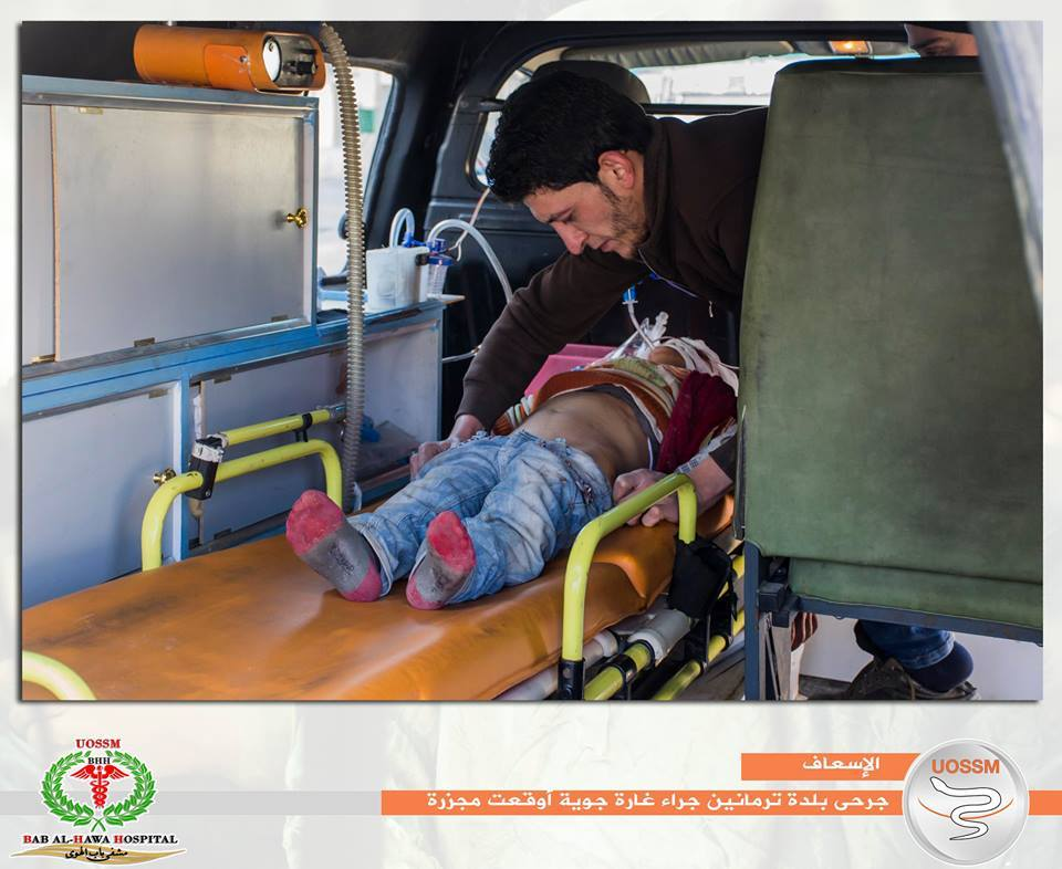 A wounded child is placed in an ambulance after an alleged Russian airstrike on Termanin, Jan 25th (via SNN)