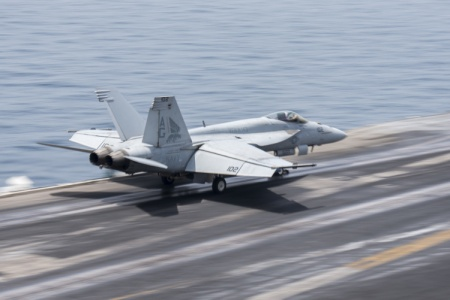 "An F/A-18E Super Hornet, assigned to the ""Pukin' Dogs"" of Strike Fighter Squadron (VFA) 143, launches from the flight deck of aircraft carrier USS Harry S. Truman (US DoD)"