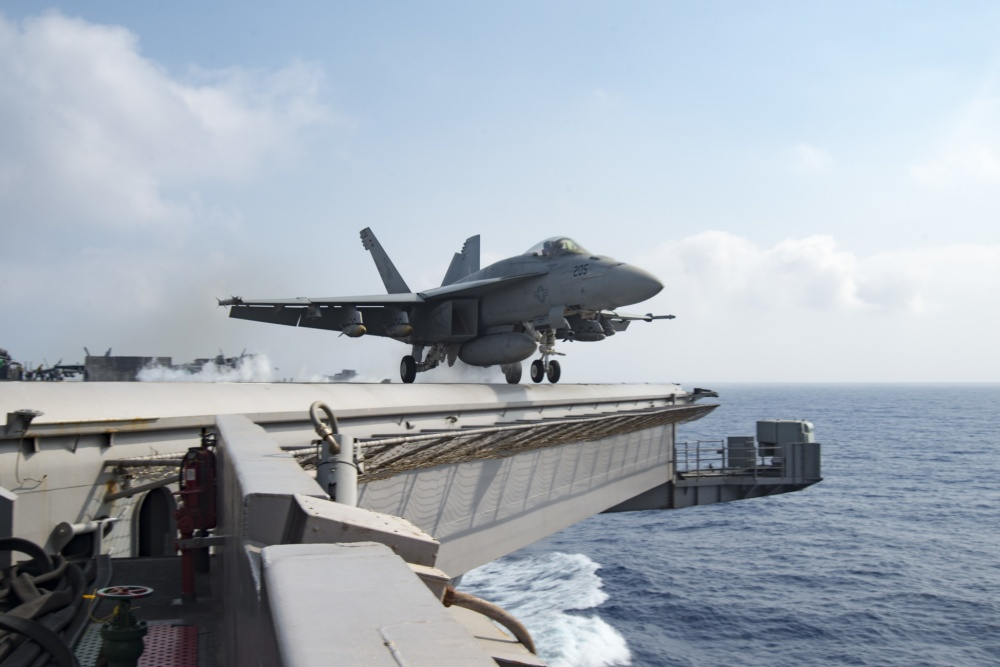 An F/A-18E Super Hornet assigned to the Sidewinders of Strike Fighter Squadron (VFA) 86 launches from the flight deck of the aircraft carrier USS Dwight D. Eisenhower (CVN 69) [US Navy]