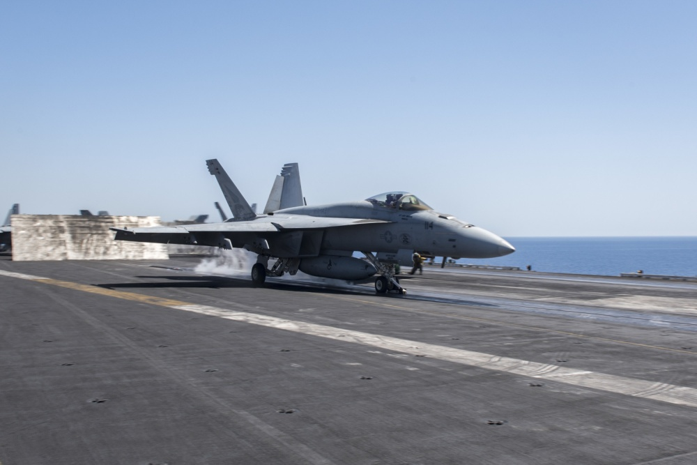 "An F/A-18E Super Hornet assigned to the ""Pukin' Dogs"" of Strike Fighter Squadron (VFA) 143, launches from the flight deck of aircraft carrier USS Harry S. Truman [US Navy]"