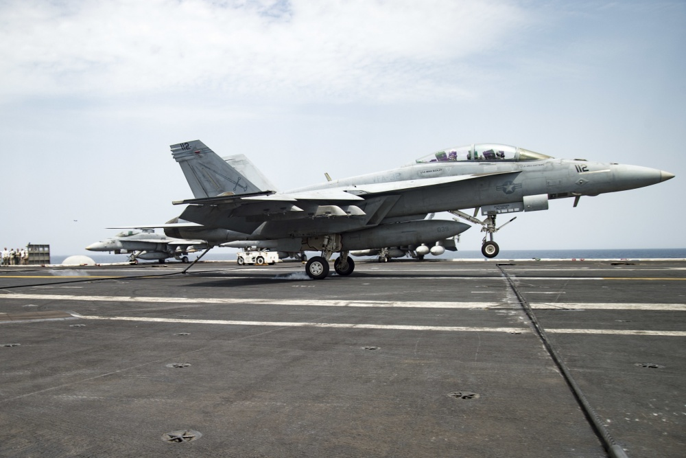 n F/A-18F Super Hornet assigned to the Fighting Swordsmen of Strike Fighter Squadron (VFA) 32 makes an arrested landing on the flight deck of the aircraft carrier USS Dwight D. Eisenhower (US Navy)