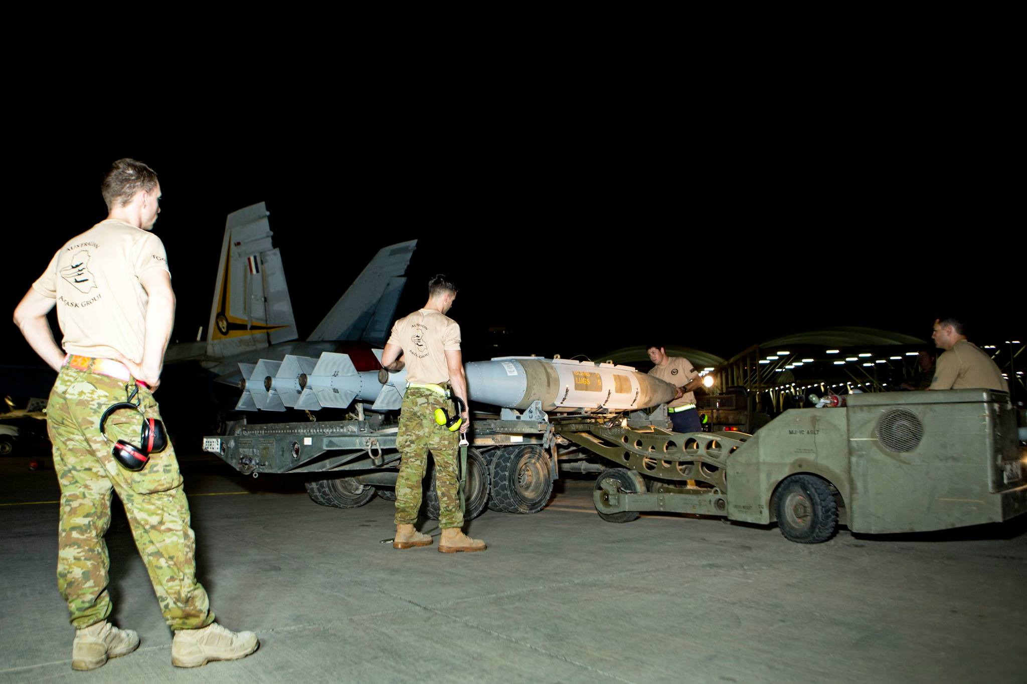 Australian armament personnel assemble and load weapons (image via CJTF OIR)