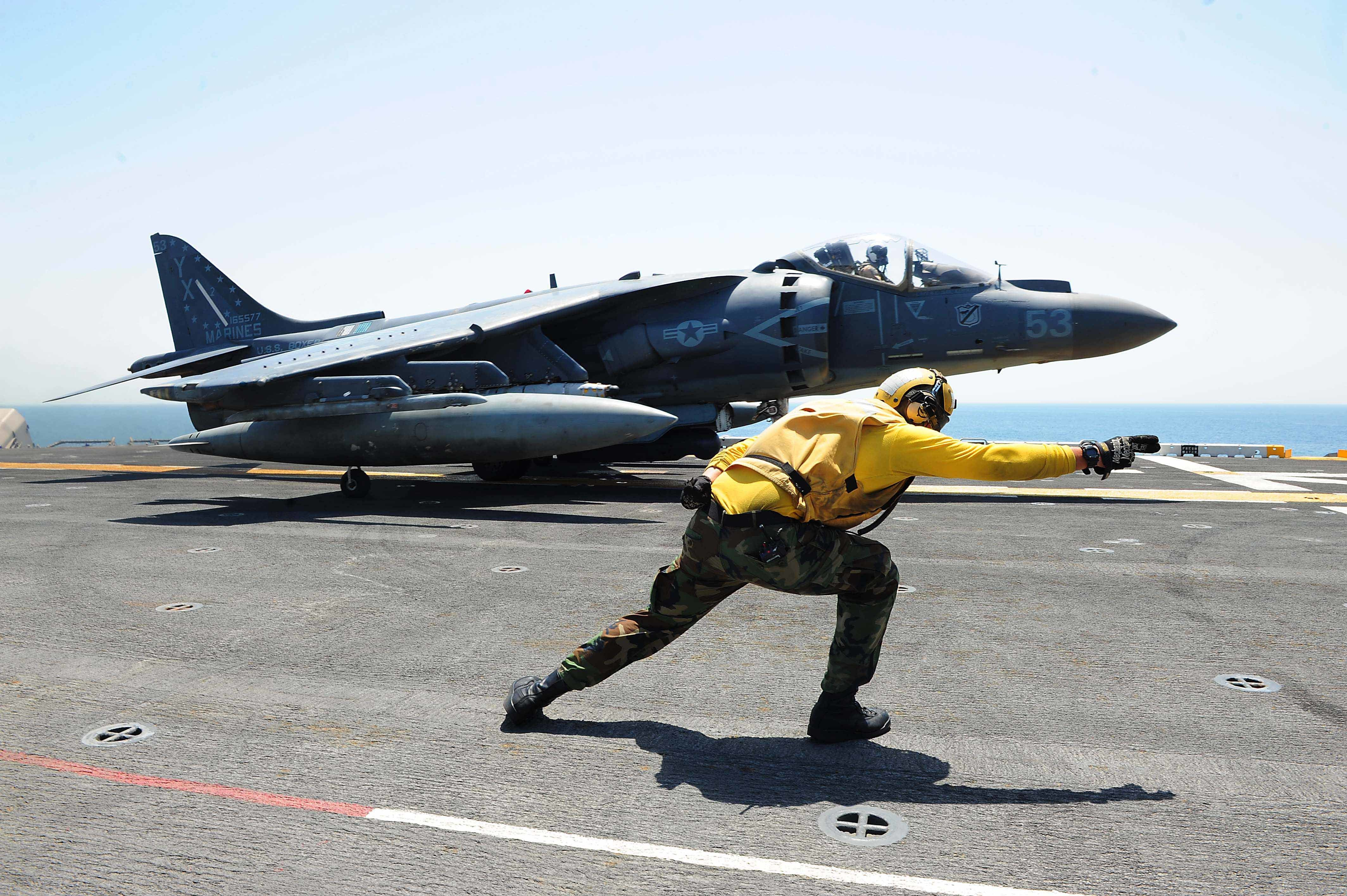 160711-N-VD165-166 ARABIAN GULF (July 11, 2016) Aviation Boatswain's Mate (Handling) 3rd Class Chase Coker launches an AV-8B Harrier II, attached to 13th Marine Expeditionary Unit (MEU), off the flight deck of amphibious assault ship USS Boxer (LHD 4). Boxer is the flagship for the Boxer Amphibious Ready Group and, with the embarked 13th MEU, is deployed in support of Operation Inherent Resolve, maritime security operations and theater cooperation efforts in the U.S. 5th Fleet area of operations. (U. S. Navy photo by Mass Communication Specialist 2nd Class Jose Jaen/Released)