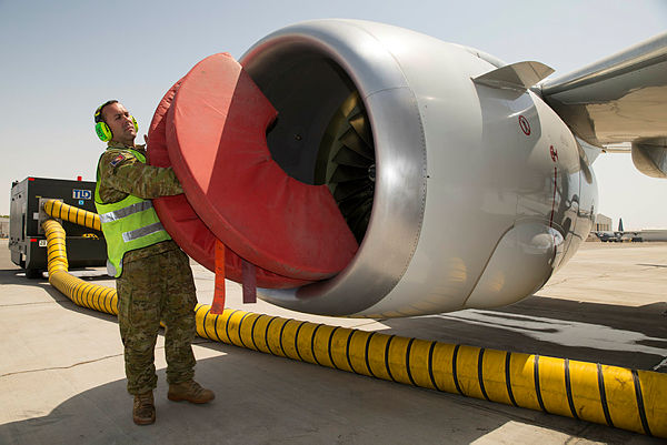 Air Task Group E-7A Detachment (Task Element 630.1.2) Rotation Six Aircraft Maintainer, Leading Aircraftman Lee Childs, removes engine protectors from a Royal Australian Air Force E-7A Wedgetail aircraft, prior to an inspection, at Australia's main support base in the Middle East region. (Aus MoD)