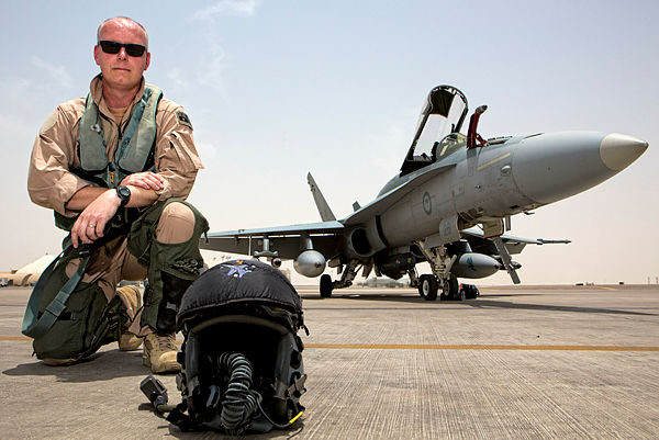 Commander Air Task Group, Air Commodore Philip Gordon, in front of an F/A-18A Hornet on the flight line of Australia's main air operating base in the Middle East region. (Aus MoD)