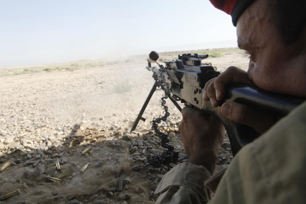 An Iraqi soldier fires a Pulemyot Kalashnikova machine gun during squad automatic weapons training at Camp Taji, Iraq (US Army)