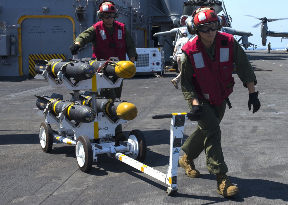 Marines transport AGM-114 Hellfire missiles across the flight deck aboard the amphibious assault ship USS Wasp (US Navy)