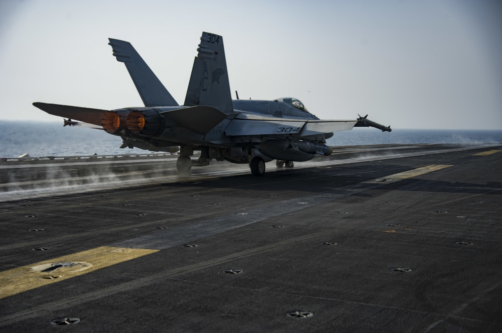 An F/A-18C Hornet assigned to the Wildcats of Strike Fighter Squadron (VFA) 131 launches from the flight deck of the aircraft carrier USS Dwight D. Eisenhower (US Navy)