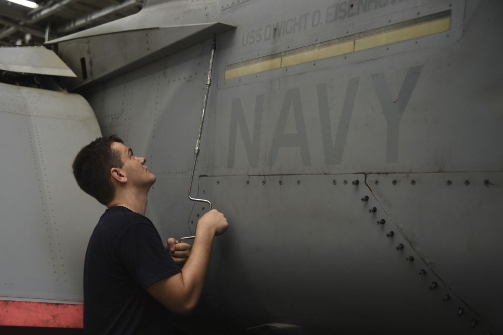 Aviation Structural Mechanic Airman Zachary Potts, from Hickory, N.C., conducts maintenance on the trailing edge flat fairing panel of an F/A-18E Super Hornet assigned to the Sidewinders of Strike Fighter Squadron (VFA) 86 in the hangar bay of the aircraft carrier USS Dwight D. Eisenhower (US Navy)