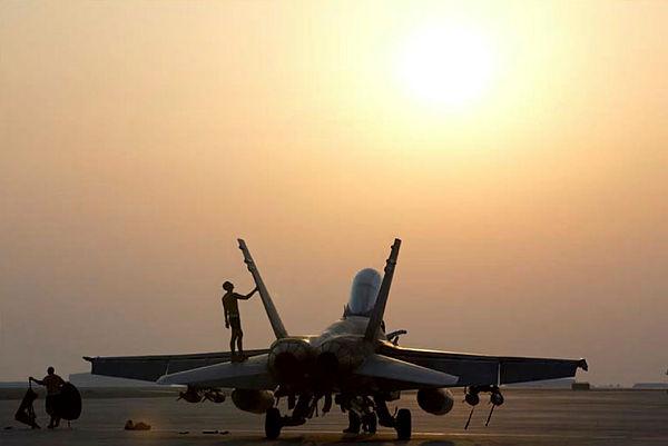 An Air Task Group Strike Element member conducts maintenance on a Royal Australian Air Force F/A-18A (Aus MoD)