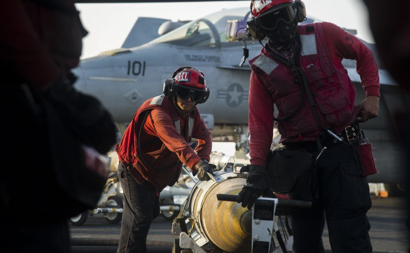 Sailors load a 2,000lb bomb onto an FA/18 Super Hornet aboard the USS Dwight D Eisenhower , July 31st 2016 (US Navy/ Mass Communication Specialist 3rd Class Nathan T. Beard)    ARABIAN GULF (July 31, 2016) – Sailors assigned to the aircraft carrier USS Dwight D. Eisenhower (CVN 69) (Ike) transport an MK 84/BLU 117 2,000-pound general-purpose bomb. Ike and its Carrier Strike Group are deployed in support of Operation Inherent Resolve, maritime security operations and theater security cooperation efforts in the U.S. 5th Fleet area of operations. (U.S. Navy photo by Mass Communication Specialist 3rd Class Nathan T. Beard/Released)