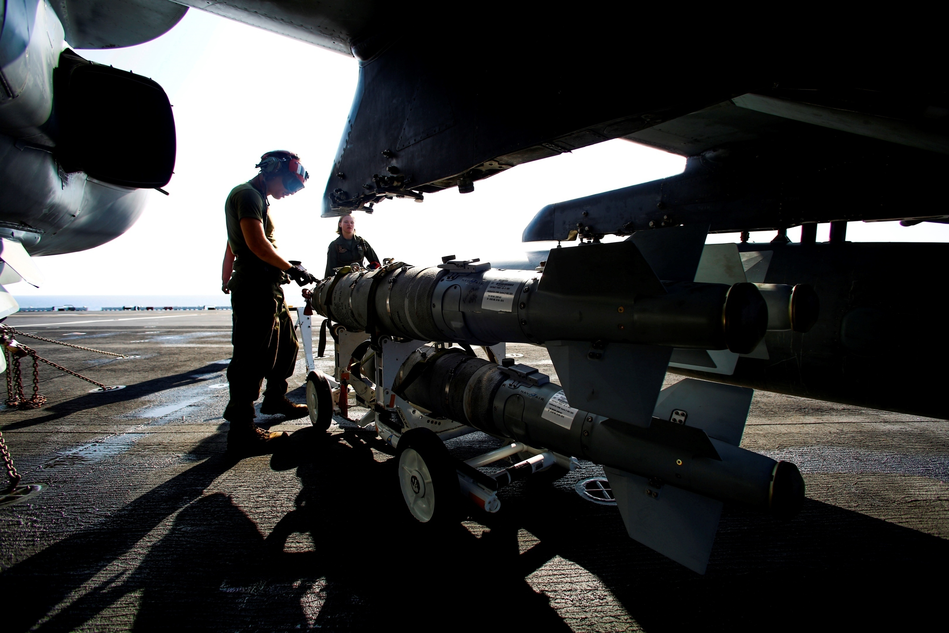Marines from 22nd US Marine Expeditionary Unit load ordnance on an AV-8B Harrier II on the amphibious assault ship USS Wasp on Aug. 2nd 2016 (USMC/ Cpl. Ryan G. Coleman)