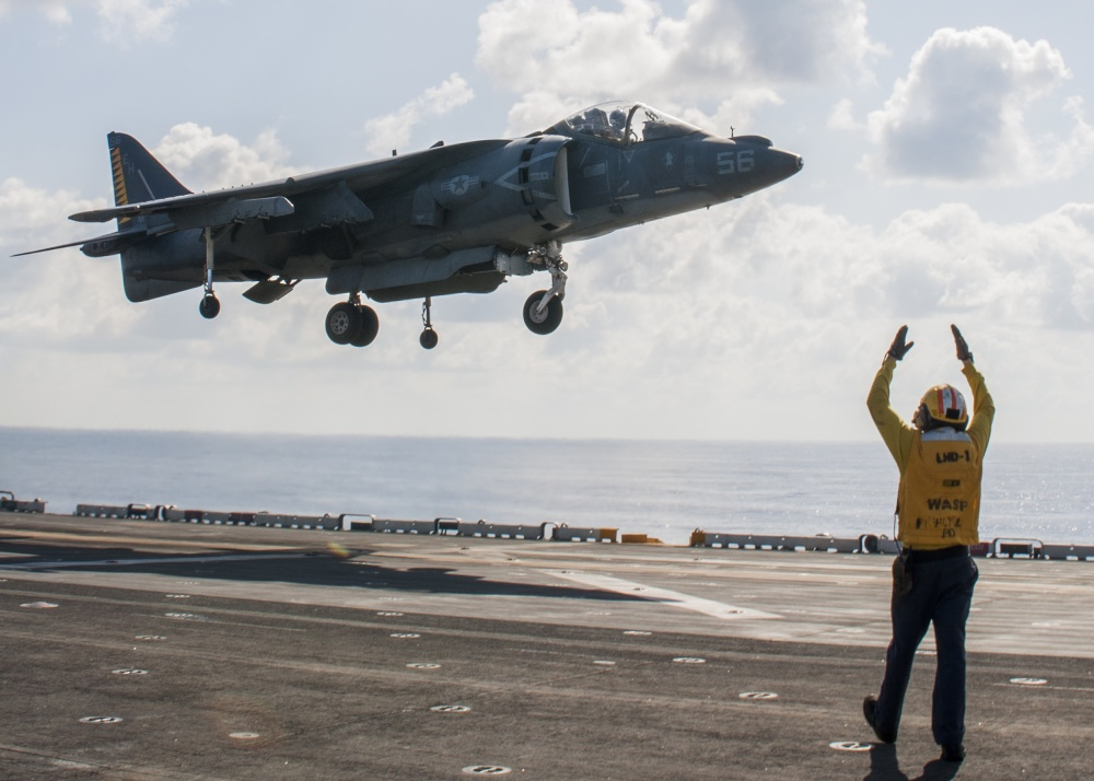 An AV-8B Harrier performs a vertical take off from USS Wasp, Oct 12th (US Navy)