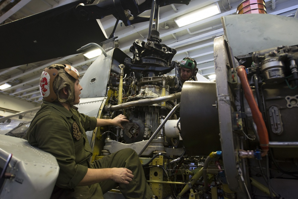 Maintenance is performed on an AH-1W Super Cobra, Oct 3rd (US Navy)