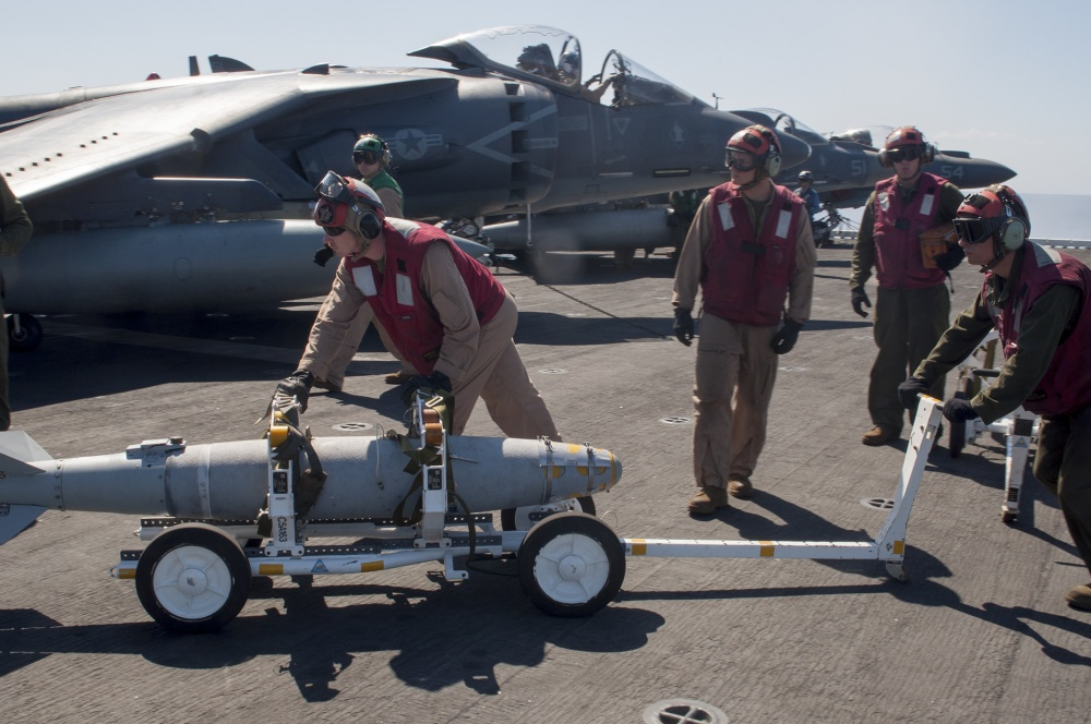 Ordnance is loaded onto an AV-8B Harrier aboard USS Wasp (US Navy)