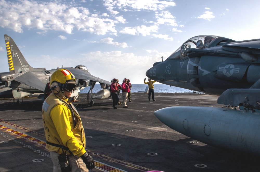 Sailors maneuver an AV-8B Harrier on the flight deck of USS Wasp, Sept 21st (US Navy)