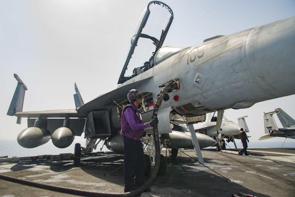 Airman Justin Saulbury, of Gainesville, Va., fuels an F/A-18F Super Hornet assigned to the Fighting Swordsmen of Strike Fighter Squadron (VFA) 32 on the flight deck of the aircraft carrier USS Dwight D. Eisenhower (US Navy)