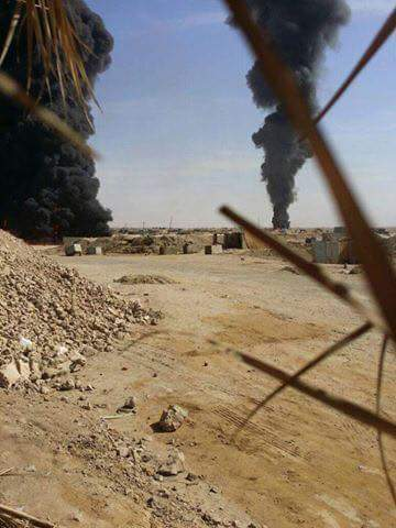 A burning oil facility in the al Baghouz dsert after being hit in a Coalition strike October 16th 2016. At least 10 civilian workers reportedly died (via Sound and Vision)