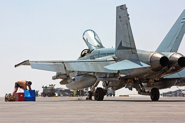 An Air Task Group Strike Element member conducts maintenance on a Royal Australian Air Force F/A-18A Hornet (Aus MoD)