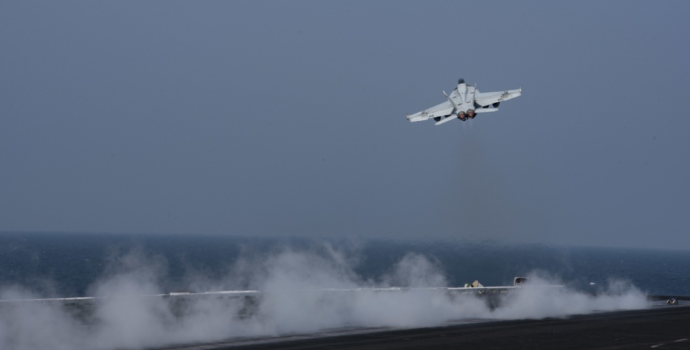 An F/A-18E Super Hornet launches from the flight deck of USS Dwight D. Eisenhower, Oct 20th (US Navy)
