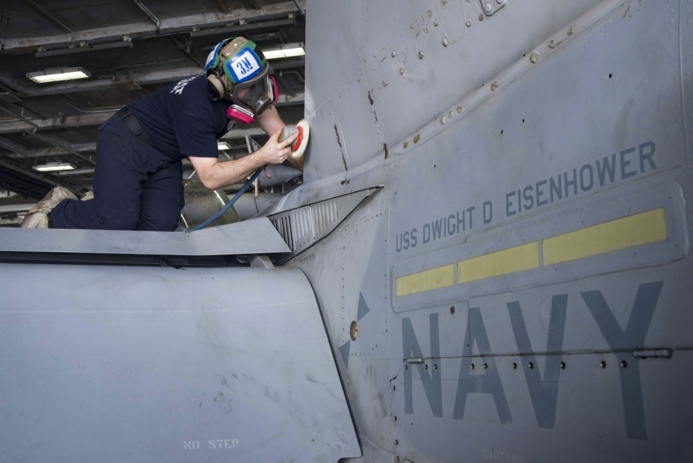 Corrosion is removed from an F/A-18C Hornet, Oct 27th (US Navy)