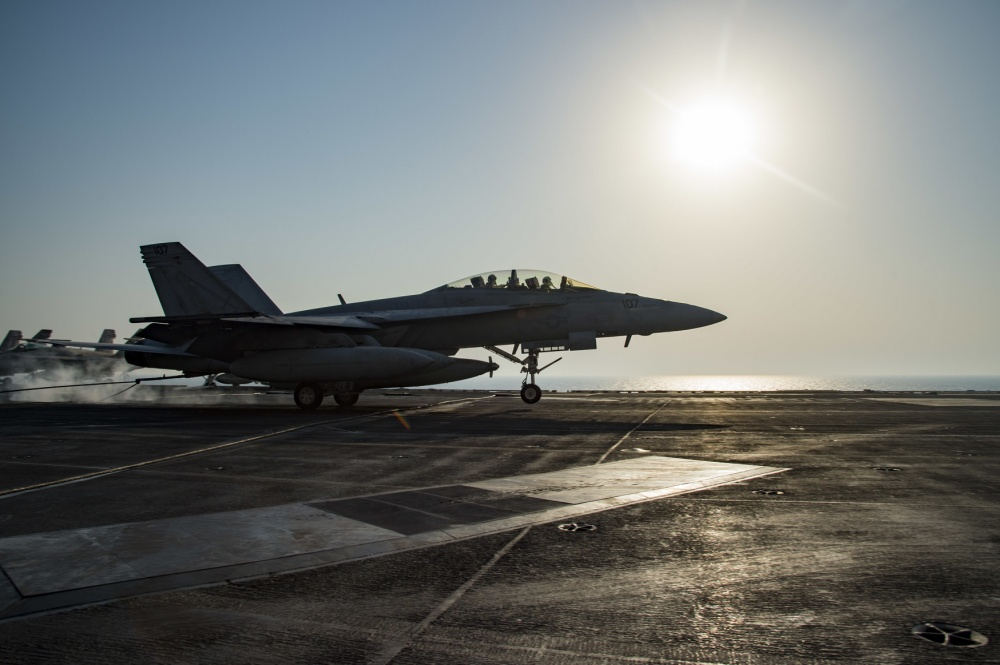 An F/A-18F Super Hornet makes an arrested landing on the flight deck of USS Dwight D. Eisenhower, Sept 18th (US Navy)