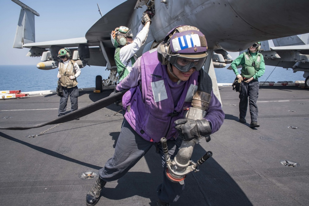 A refueling hose is brought onto the flight deck of the aircraft carrier USS Dwight D. Eisenhower , Oct 6th (US Navy)