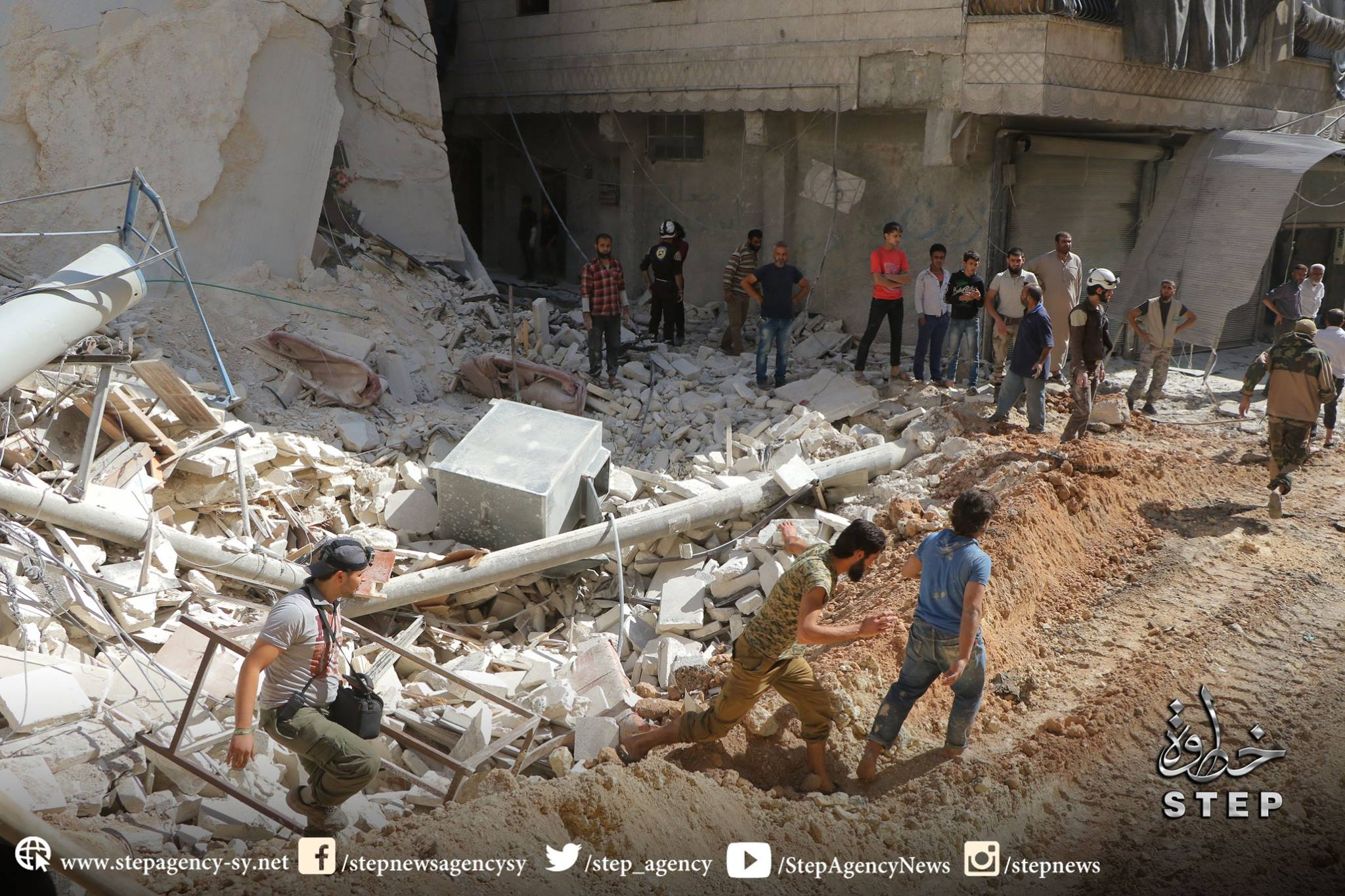The White Helmets attend the scene of an allaged Russian strike on Al Ferdos, Aleppo on Oct 11th (via Step)