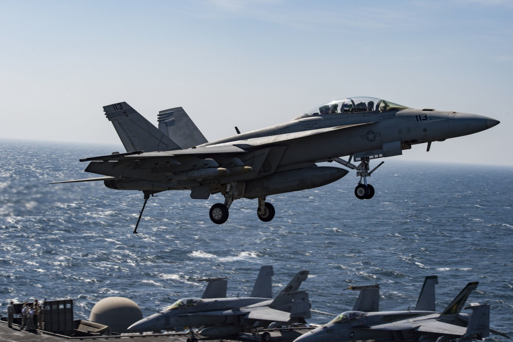 An F/A-18F Super Hornet flies over the flight deck of the aircraft carrier USS Dwight D. Eisenhower, Nov 10th (US Navy)