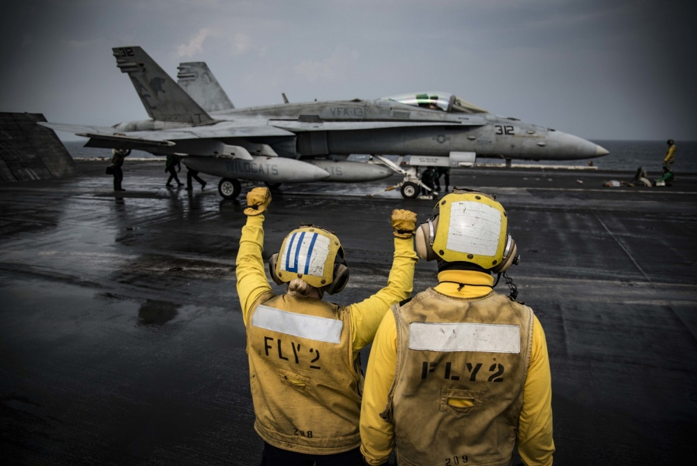An F/A-18C Hornet prepares to launch from the flight deck of the aircraft carrier USS Dwight D. Eisenhower, Nov 24th (US Navy)