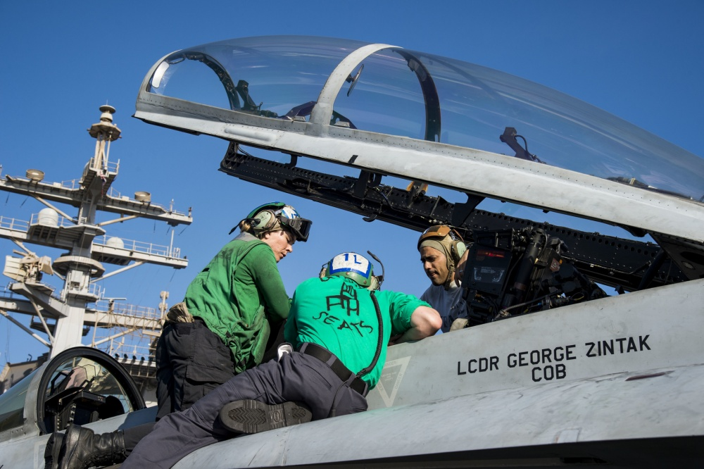 A foreign object debris check is carried out in the cockpit of an F/A-18F Super Hornet, Nov 9th (US Navy)