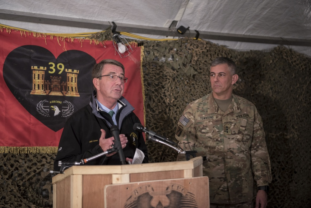 Secretary of Defense Ash Carter and U.S. Army Lt. Gen. Stephen Townsend, commander of Combined Joint Task Force Operation Inherent Resolve, host a joint press conference at Qayyarah Airfield West, Iraq, Dec. 11 (DoD)