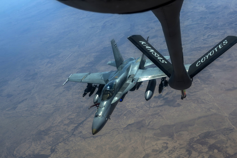 A Royal Australian Air Force F/A-18 Super Hornet flies behind a U.S. Air Force KC-135 Stratotanker for aerial refueling in support of an Operation Inherent Resolve mission Feb. 22, 2017 (U.S. Air Force photo by Staff Sgt. Matthew B. Fredericks)